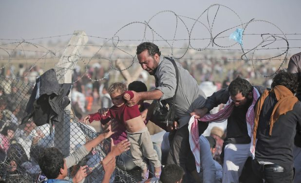 This image has an empty alt attribute; its file name is World-Refugee-Crisis-618x376-1.jpg